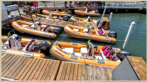 View Kayaking Puerto Rico Mini Boats at the docks while guests receive orientation before a snorkeling in puerto rico adventure to icacos puerto rico